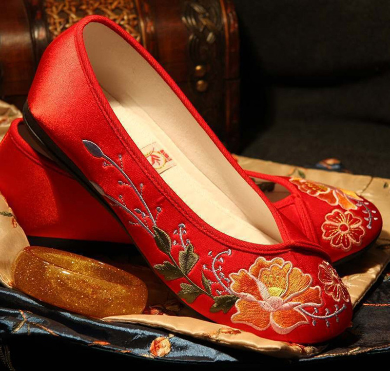 Stepping embroidered shoes in Zhangjiajie